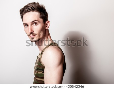 Young attractive man in army undershirt. - stock photo