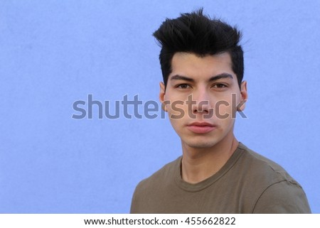 Young attractive man in blue background with copy space - stock photo