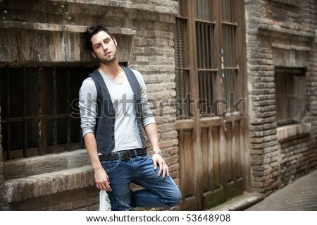 Young attractive man in urban background - stock photo