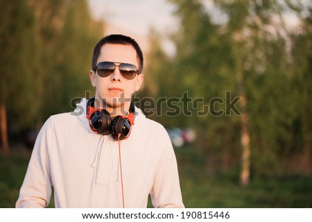 Young attractive man outdoor - stock photo