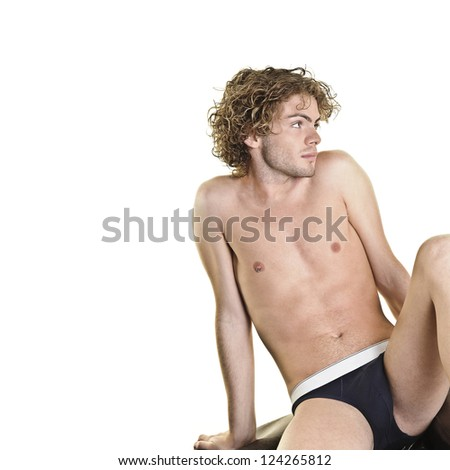Young attractive man posing on white background (room to add text) - stock photo