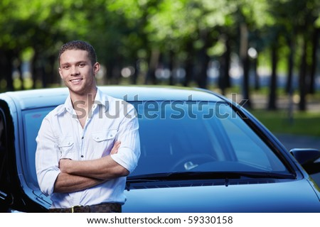Young attractive man with car - stock photo