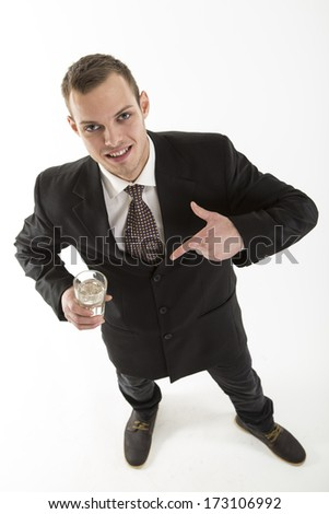 young attractive man with drink glass on white - stock photo