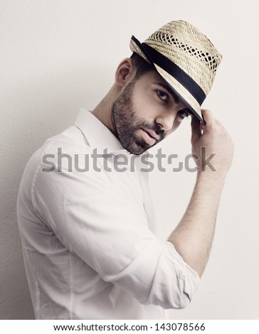 Young attractive man with modern hat - stock photo