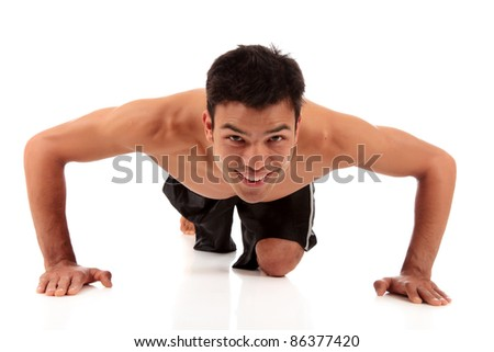 Young attractive Nepalese male working out , fitness exercise. Studio shot. White background. - stock photo