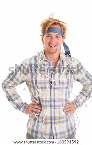 Young attractive party guy with a tie around his head, wearing a shirt and grey pants. White background. - stock photo