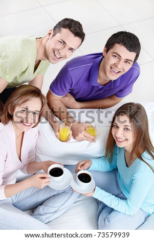 Young attractive people with drinks - stock photo
