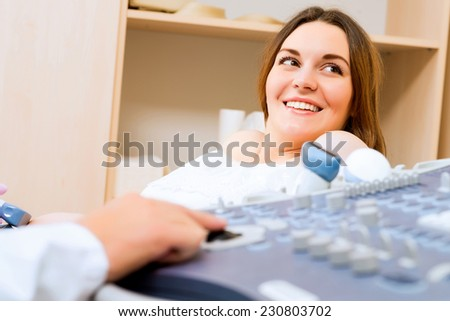 Young attractive pregnant woman on reception at the doctor, health check - stock photo