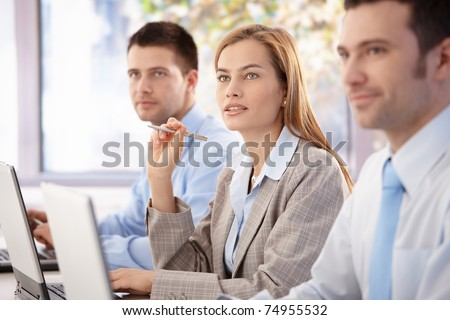 Young, attractive professionals having business training.? - stock photo
