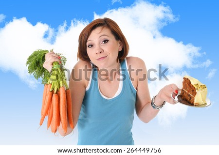 young attractive read hair woman outdoors holding green apple and sweet cake in fitness, diet and healthy nutrition concept in health and natural food versus junk and sweet  - stock photo