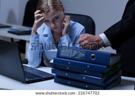 Young attractive secratary working after hours in company - stock photo