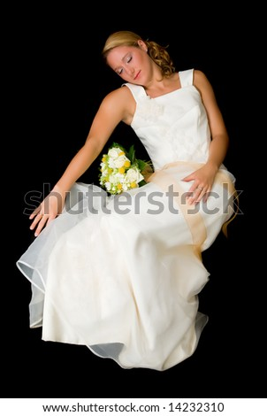 Young attractive sleeping bride.  Black background, studio shot.