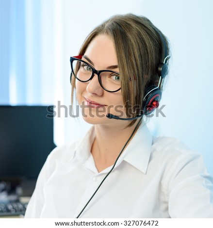 Young Attractive Smiling Customer Support Phone Operator with Headset in the Office. - stock photo
