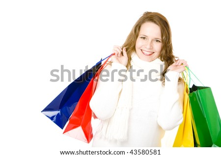 Young attractive smiling woman holding shopping bags. Isolated on white. - stock photo