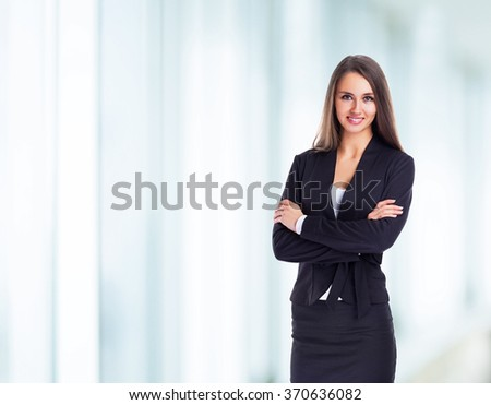 Young, attractive, successful business woman, confidently looking forward.