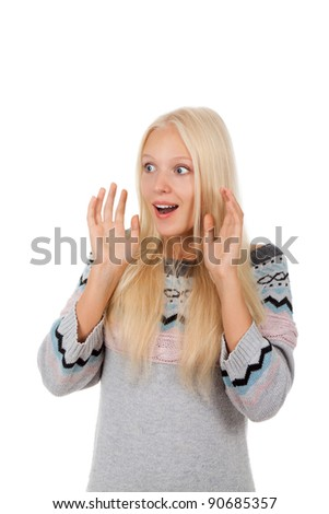 Young attractive surprised excited smile woman looking side to empty copy space, wear winter knitted warm sweater, isolated over white background - stock photo