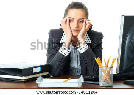 young attractive tired, overworked and exhausted female office worker in grey suit, isolated on white - stock photo