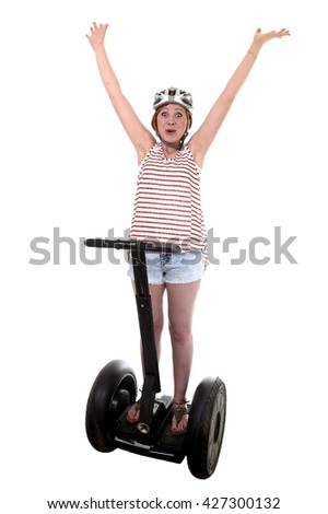 young attractive tourist woman wearing safety helmet rising arms up hands free smiling happy riding electrical segway having fun driving isolated on white background in ecological transport concept - stock photo