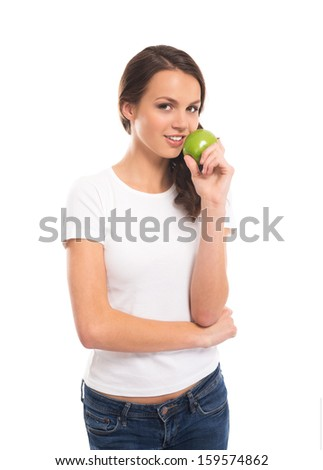 Young, attractive vegetarian girl with the green apple isolated on white - stock photo
