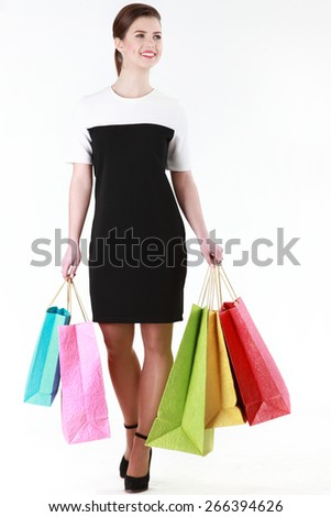 Young attractive woman does shopping - stock photo