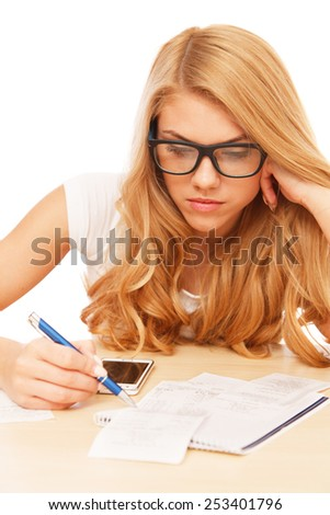 Young attractive woman doing her accounts - stock photo