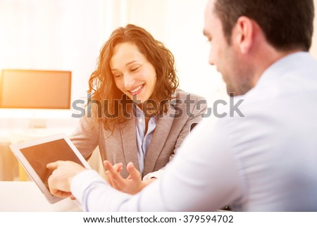 Young attractive woman during job interview - stock photo