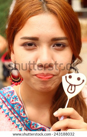 Young attractive woman eat chocolate, close up - stock photo