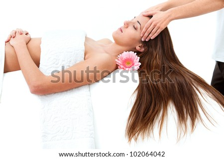 Young attractive woman enjoying head massage.Isolated on white. - stock photo