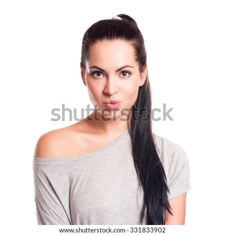 Young attractive woman face over isolated white background - stock photo
