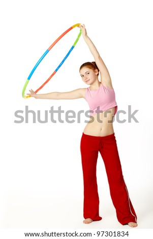 Young attractive woman fitness instructor holding hula hoop