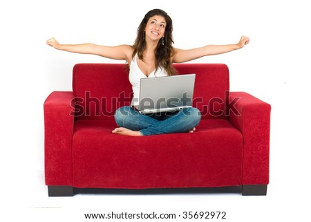 young attractive woman happy about something on her notebook - stock photo