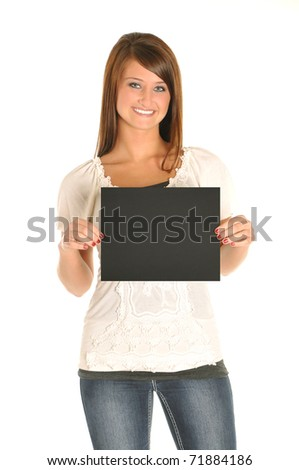 Young attractive woman holding a sign - stock photo