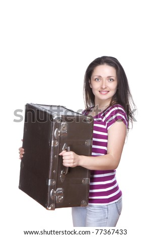 Young attractive woman holding heavy old vintage suitcase, baggage isolated over white background. Move concept