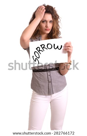 Young attractive woman holding paper with Sorrow text on white background