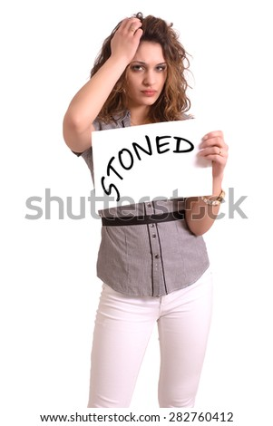 Young attractive woman holding paper with Stoned text on white background