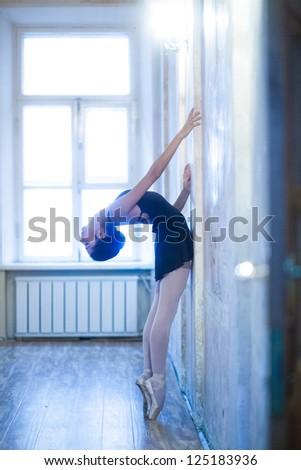 Young attractive woman in a dance class. Ballerina - stock photo