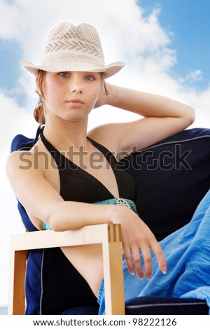 young attractive woman in beach cafe - stock photo
