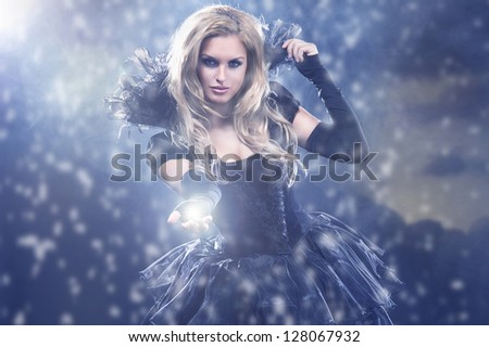 Young attractive woman in blowing silk - stock photo