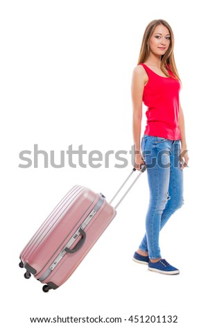 Young attractive woman in blue jeans with a suitcase isolated on white background.