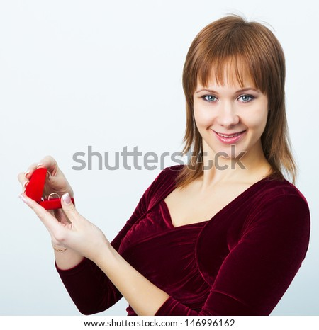 young attractive woman in evening dress with a box for rings - stock photo