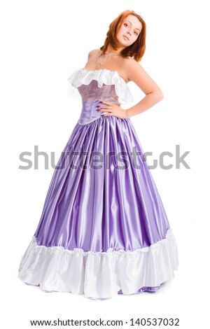 young attractive woman in long lilac-coloured ball dress isolated on white background  - stock photo