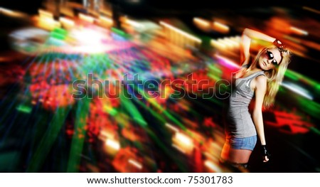 young attractive woman in nightclub - stock photo