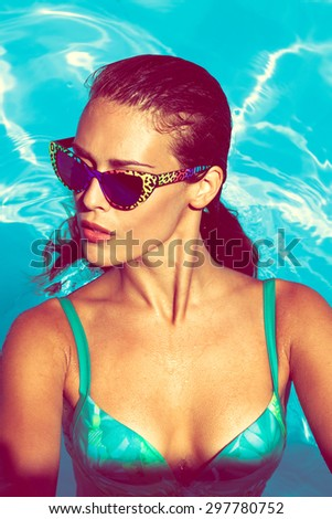 young attractive woman in  pool - stock photo