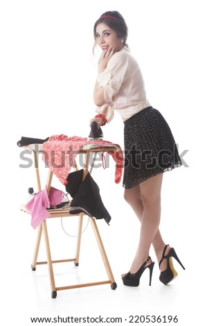 Young Attractive Woman Ironing Clothes On Ironing Board - stock photo