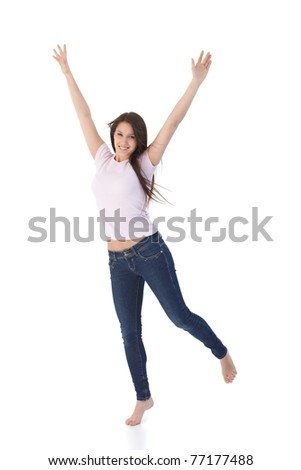 Young attractive woman jumping up happily.?