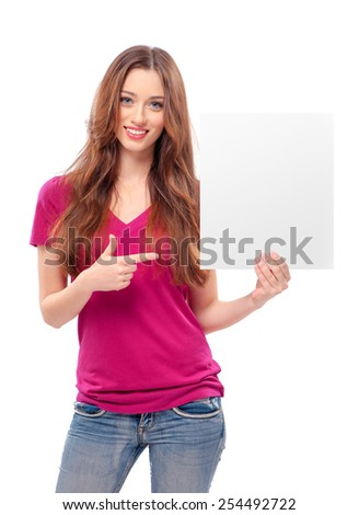 Young attractive Woman keeps and points with hand at the copyspace, isolated on white - stock photo