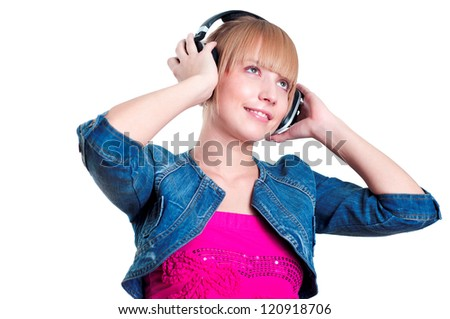 Young attractive woman listing to music with headphones against white background