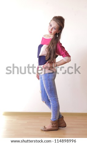 Young attractive woman looking at camera with confidence indoors full length - stock photo
