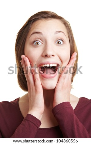 Young attractive woman looking happily surprised into the camera - stock photo