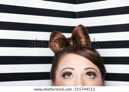Young attractive woman looking up - stock photo